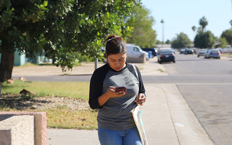 Viri Hernandez revisits heavily Latino neighborhoods in western Maricopa County on Oct. 29, 2016 to ensure voters have mailed in their ballots. (Photo by Andres Guerra Luz/Cronkite News)