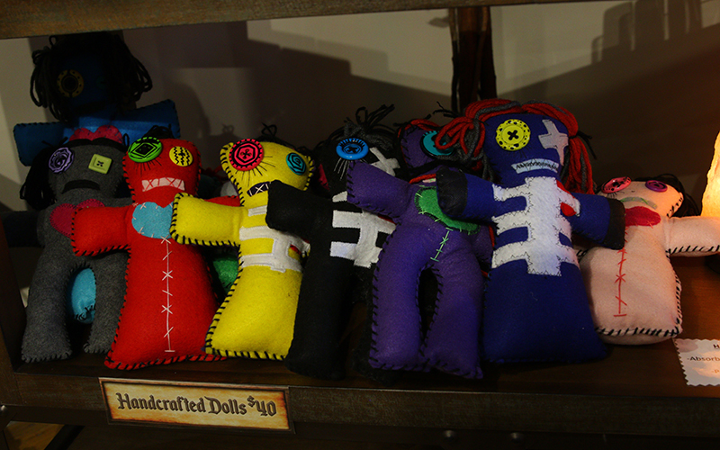 Handcrafted voodoo dolls by K-Ta Buathier line a shelf in Buried Treasures in Phoenix. (Photo by Sophie Blaylock/Cronkite News)
