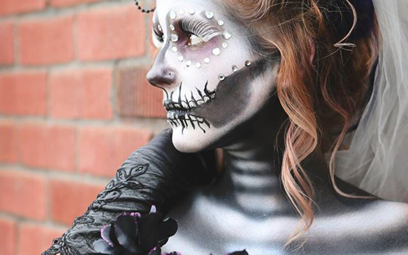 Suzie Deadmond, a stylist at R Salon in Phoenix, models Day of the Dead makeup for a photoshoot. (Photo courtesy of Rachel Tabron/Araya Photography)
