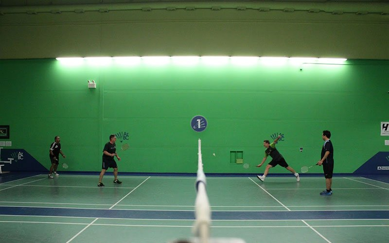 The Arizona Badminton Center has specially placed air-conditioning and lighting to keep them from becoming a hindrance to players. The green walls also help with shuttlecock visibility. (Photo by Michael Boylan/Cronkite News)