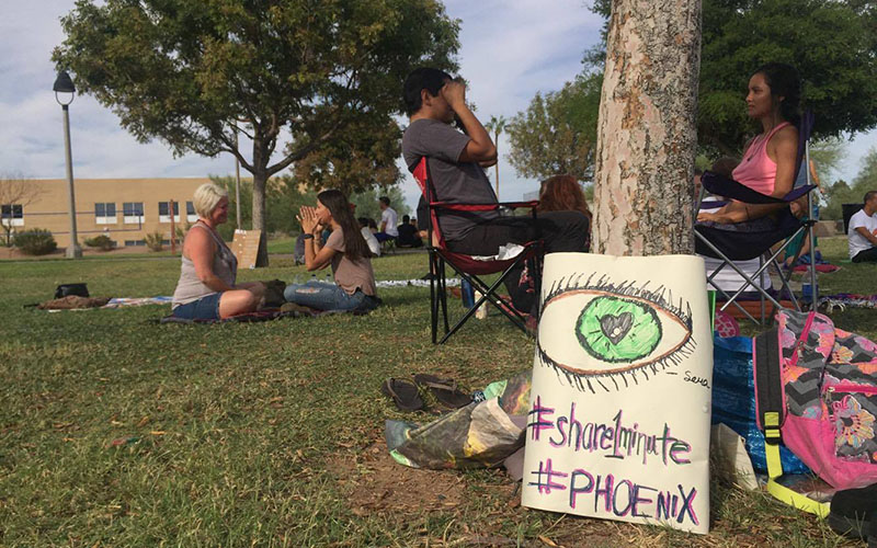 Valley residents stare into each other's eyes for one minute to participate in the World's Biggest Eye Contact Experiment at Steele Indian School Park in Phoenix, Ariz. on Oct. 30, 2016. (Photo by Danielle Quijada/Cronkite News)