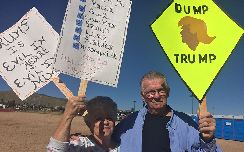Annette and Rich Tomshack protest Republican presidential candidate Donald Trump at a rally in Prescott Valley. (Photo by Bri Cossavella/Cronkite News)