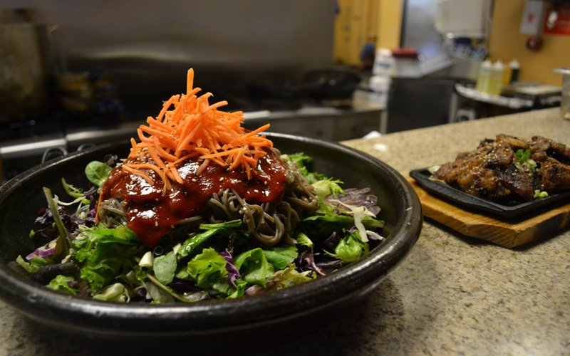The main entrée, Korean BBQ, comes with salad and spicy noodles. (Photo by SeungYeol Cho/Cronkite News)