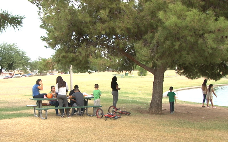 Ana Leon, with her children spending time at park in Phoenix. Leon, a domestic violence survivor, is rebuilding her life.  Photo by Yeimi Flores. (Ana Leon at the park pic)
