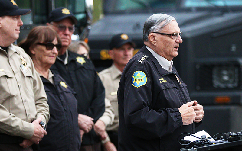 Sheriff Joe Arpaio stands in front of volunteer posse members and reflects on his 24 years in office at a press conference in the Park Central Mall parking lot on  Nov. 28, 2016. (Photo by Andres Guerra Luz/Cronkite News)