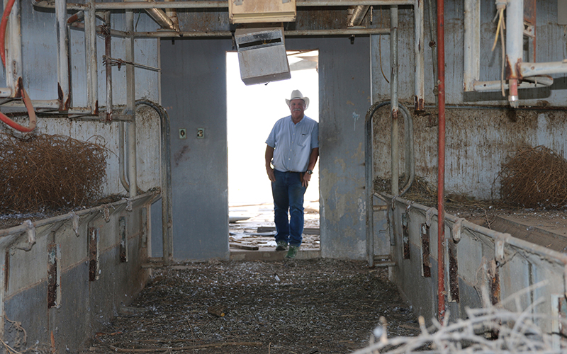 Bill Kerr, who sold his dairy farm more than a decade ago, still has vestiges of the operation behind his Buckeye home. (Photo by Kristiana Faddoul/Cronkite News)