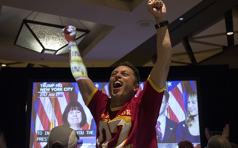 One of the Arizona GOP watch party attendees  jumps with joy as he watches a screen showing  Donald Trump's triump. (Photo by Danielle Quijada/Cronkite News)