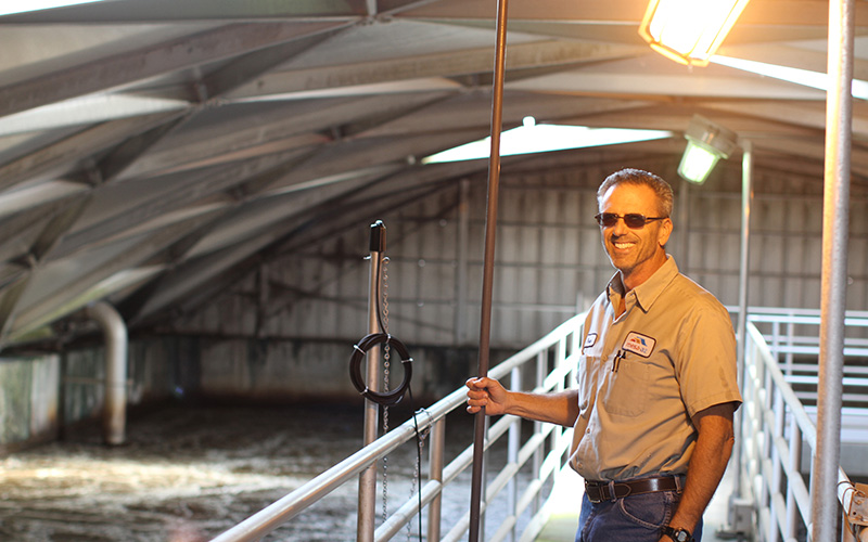 Plant operator Brian Innis stands inside an aeration basin at a wastewater treatment plan in Mesa. (Photo by Cassie Ronda/Cronkite News)