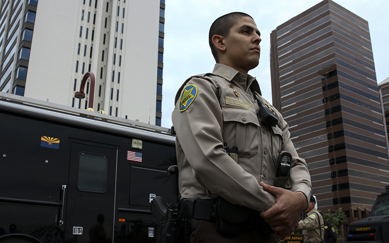 Niko Vazquez, 26, a volunteer member of the Maricopa County Sheriff's Posse, spoke positively about his  posse service at a press conference near Park Central Mall on Nov. 28, 2016. (Photo by Danielle Quijada/Cronkite News).