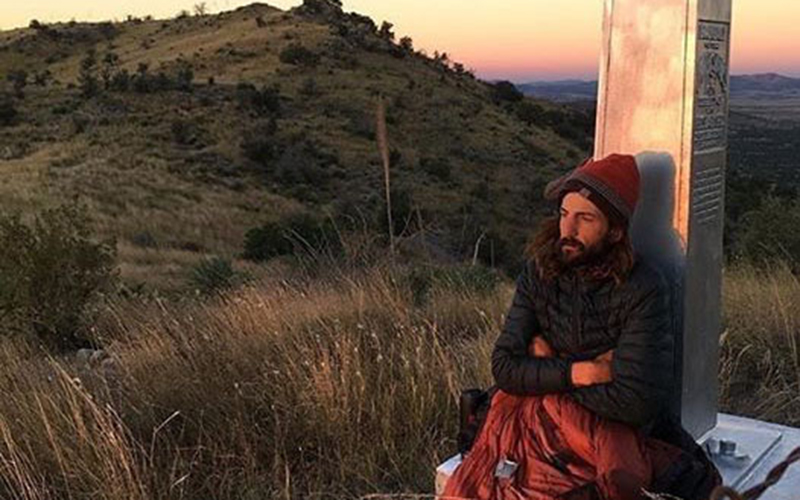 After finishing his 800-mile run of the Arizona Trail, all Michael Versteeg wanted to do was sit at the border and watch the sun rise. (Photo by Michael Versteeg)