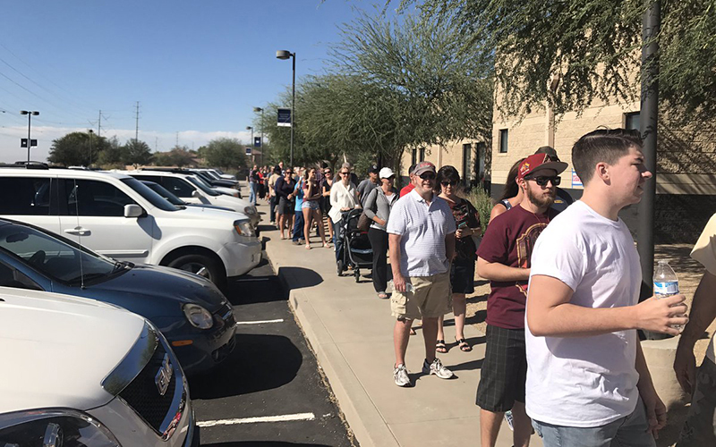 Voters at Sun Valley Community Church in Mesa say lines have been around a two hour wait all morning. (Photo by Lindsey Wisniewski/Cronkite News)