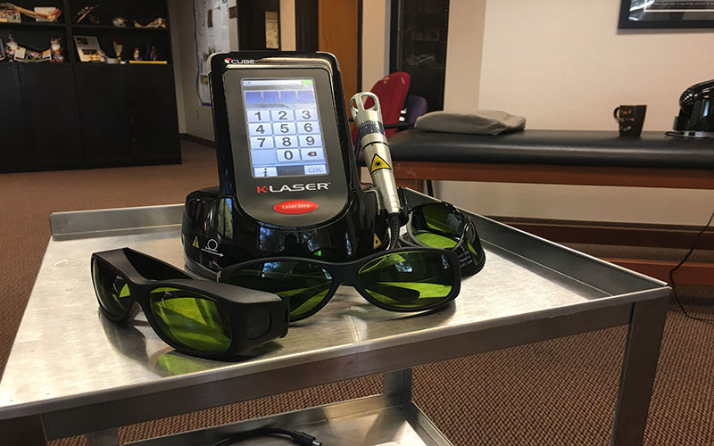 The K-Laser used at Alpha Chiropractic & Physical Therapy is moved over the skin around the affected area. Protective glasses are used to prevent the laser from acidentally shining in someone's eye. (Photo by Michael Boylan/Cronkite News)
