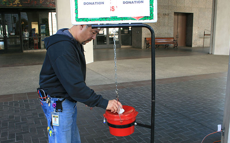 The Salvation Army is kicking off its seasonal red kettle fundraising drive on Thanksgiving, but the organization is also asking for gifts on Giving Tuesday. (Photo by Salvation Army USA West/Creative Commons)
