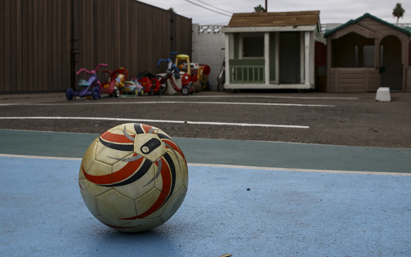 A soccer ball sits in the outside play area of Family Promise of Greater Phoenix, a nonprofit that provides shelter and services to homeless families. (Photo By Danielle Quijada/Cronkite News).