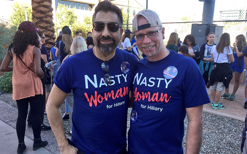 David Ruacho, left, and David Vance wear t-shirts celebrating Donald Trump's vilification of Hillary Clinton as a