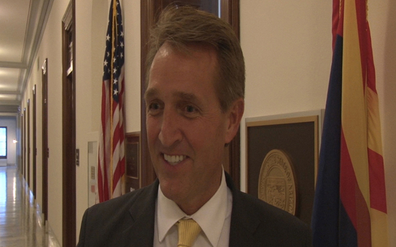 "Sen. Jeff Flake, R-Arizona, said lifting a House ban on budget earmarks is like ""feeding pork to the alligators"" at a time when voters want to ""drain the swamp"" in Washington. (Photo by Claire Caulfield/Cronkite News)"