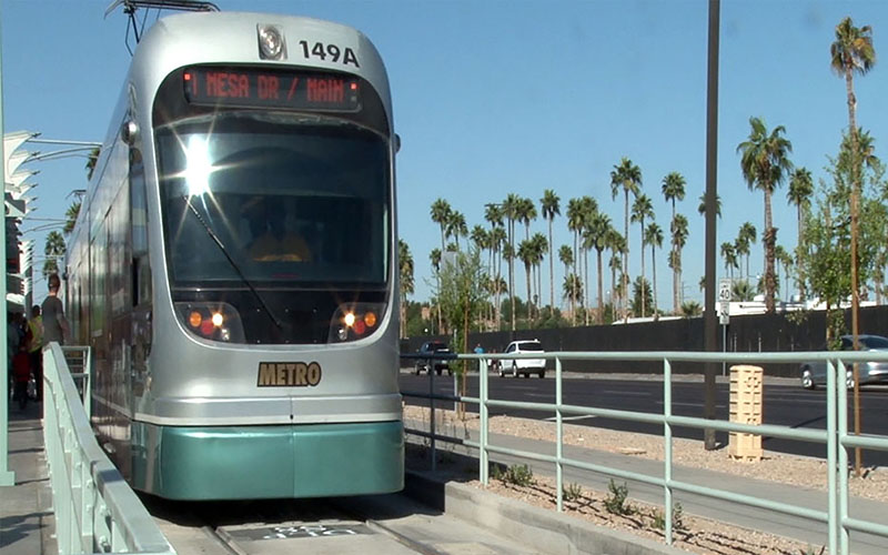 A train makes the inaugural run in March from Dunlap Station on an expanded leg of Valley Metro's light rail. Improvements in Phoenix transit were cited as a model for other cities by advocates before the election. (Photo by Elena Mendoza/Cronkite News)