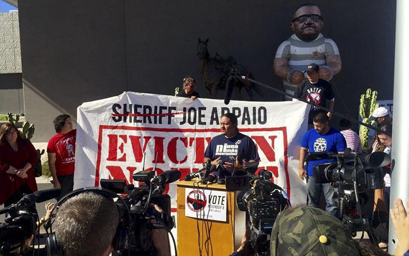 Acitvist Carlos Garcia speaks at a Bazta Arpaio gathering outside the Maricopa County Sheriff's Office on  Nov. 9, 2016. (Photo by Danielle/Cronkite News)