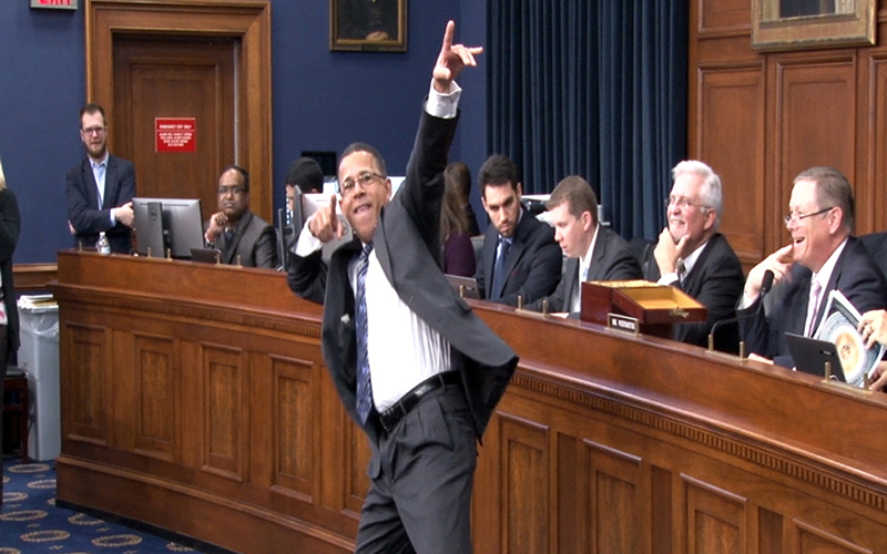 Former Maryland Lt. Gov. Anthony Brown, now a freshman member of Congress, strikes a pose before selecting his number in the office lottery. (Photo by Claire Caulfield/Cronkite News)