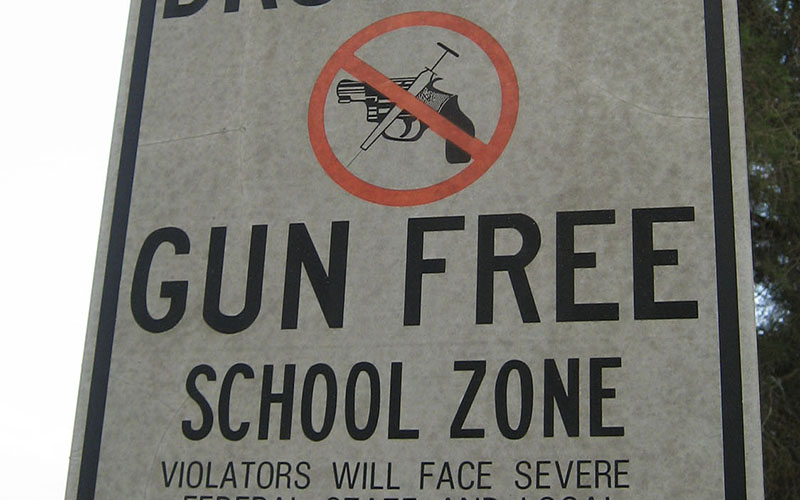 While there are federal laws concerning gun-free zones in schools, many states and local boards have their own laws and policies. Arizona school officials leave the decision to local boards. (Photo by Marcus Quigmire/Creative Commons)