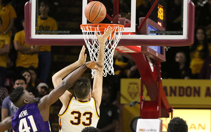 Arizona State's Ramon Vila (33) makes a layup through contact. ASU defeated Washington, 86-75, Wednesday at Wells Fargo Arena in Tempe. (Photo by Fabian Ardaya/Cronkite News)