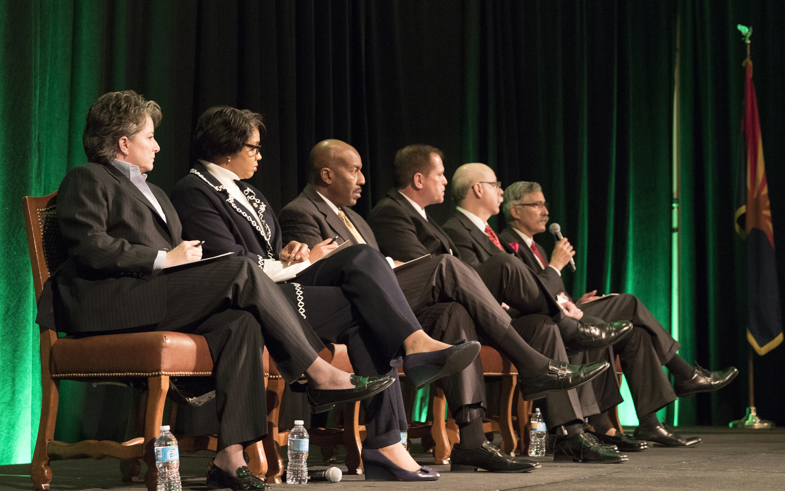 Six police chiefs from across the Valley discuss the relationship between the police and the communities they serve during the Bridge Forum in Scottsdale on Monday. The chiefs include (left to right) Tempe Chief Sylvia Moir, Phoenix Chief Jeri Williams, Peoria Chief Roy Minter, Mesa Interm Chief Michael Dvorak, Salt River Pima-Maricopa County Chief Karl Auerbach and Scottsdale Chief Alan Rodbell. (Photo by Josh Orcutt/Cronkite News)