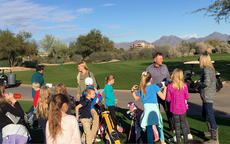 Dale Balvin works with young golfers as part of his Golf's Elementary program, an after-school program for kids ranging from 5 to 14. (Photo by Tyler Handlan/Cronkite News)