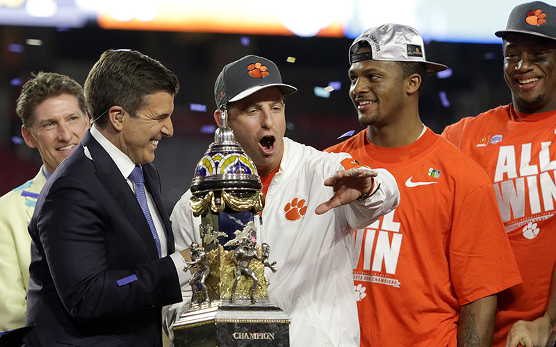 Clemson head coach Dabo Swinney speaks at the trophy presentation after the PlayStation Fiesta Bowl at University of Phoenix Stadium in Glendale on Saturday, Dec. 31, 2016. The Clemson Tigers beat the Ohio State Buckeyes, 31-0. (Photo by Logan Newman/Cronkite News)