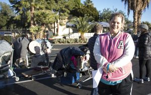 Betty Jean-Rider poses for a portrait in front of her possessions after completing the Point-in-Time homeless count survey on Tuesday. (Photo by Tynin Fries/Cronkite News)