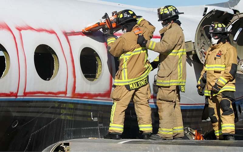 Mesa Fire and Medical Department firefighters cut out the windows of a Gulfstream Jet during a training exercise. (Photo by Alyssa Hesketh/Cronkite News)