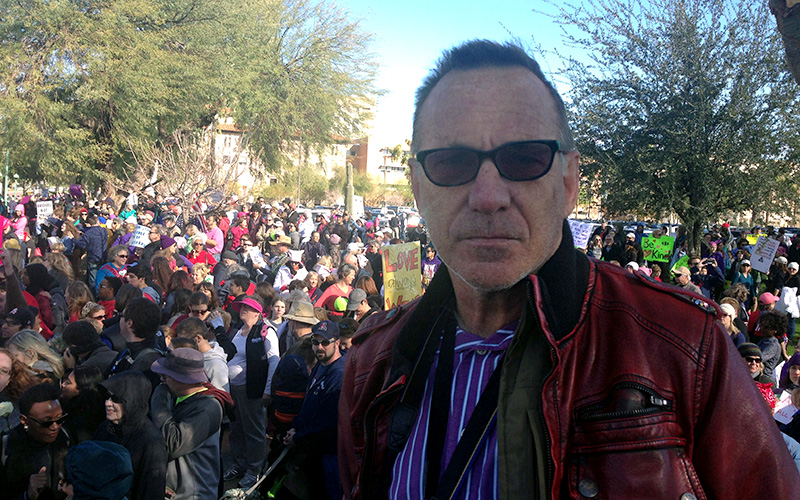 World traveler and photographer Brent Bishop, 60, walked in the Phoenix march to support his daughter, who walked in the Washington, D.C. march. (Photo by Saundra Wilson/Cronkite News)