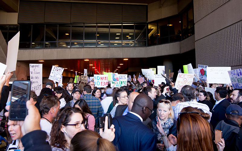 A crowd of about 700 stands outside Sky Harbor International Airport on Sunday, Jan. 29, 2017, as protests broke out at other airports across the U.S. spurred by President Donald Trump's executive order to ban immigrants from entering the U.S. from seven primarily Muslim countries. (Photo by Ryan Santistevan/Cronkite News.)