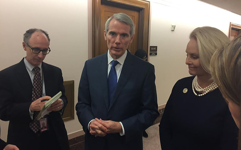 Sen. Rob Portman, R-OH and Cindy McCain speak to reporters after a hearing on Tuesday, January 10.