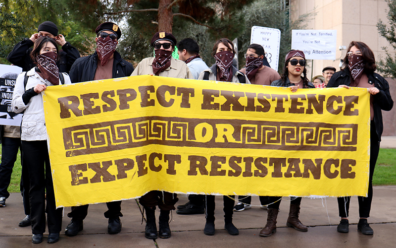 The Brown Berets started as a group advocating for positive Chicano interactions with law enforcement. The Arizona chapter stood outside the Arizona State Capitol on Inauguration Day to protest President Trump. (Photo by Nicole Tyau/Cronkite News)