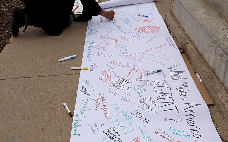"Protest attendees wrote personal notes about ""What Makes America Great,"" with responses ranging from ""love"" to ""free speech"" to ""respect."" The sign was inscribed at the inauguration protest at the Arizona State Capitol on Jan. 20, 2017. (Photo by Nicole Tyau/Cronkite News)"