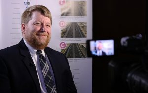 Robert Hazlett, senior engineering project manager for Maricopa Association of Governments, talks about improvements to the spine corridor. (Photo by Jessica Clark/Cronkite News)