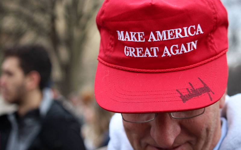 Tucson resident Greg Shimn displays his signed Make America Great Again hat, a common sight among the thousands who turned out on the National Mall for President Donald Trump's swearing-in. (Photo by Kendra Penningroth/Cronkite News)