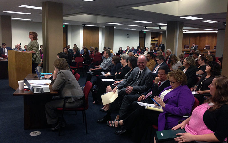 People filled an Arizona Senate health and human services committee meeting, listening to Julia Jones explain why she opposed a bill protecting health-care providers dealing with patients' end-of-life choices. (Photo by Saundra Wilson/Cronkite News)