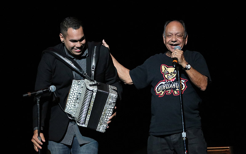 """Cheech Marin (right) thanks the audience after performing his song """"Mexican American"""" with Jonathan Molina, an ASU music education student. (Nicole Tyau/Cronkite News)"""
