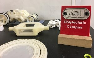 3-D printer items and sign that says ASU Polytechnic Campus