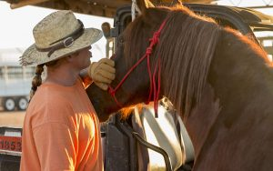 "Rick Kline, an inmate at the Florence prison, says he has been a part of the wildhorse and burro  program for six months. ""It helps you work on yourself,"" said Kline, while taking care of Bear.  (Photo by Blake Hemmel/Cronkite News)"