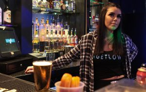 "Nicollette Davis, a bartender at Low Key Piano Bar in Tempe, talks about the importance of the ""Angel Shot."" (Photo by Erica Apodaca/Cronkite News)"