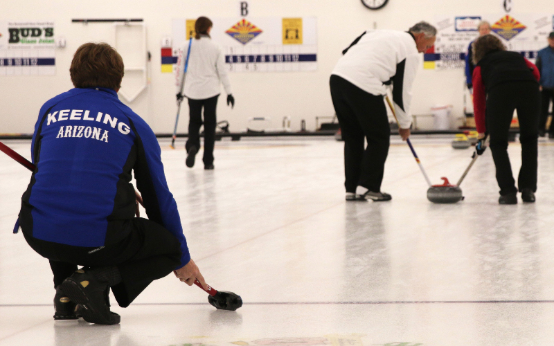 Sean Keeling watches his curling stone head down the ice during the Canada Week Bonspiel at Coyotes Curling Club, Friday, February 3, 2017 in Tempe, AZ. (Shane DeGrote/Cronkite News)