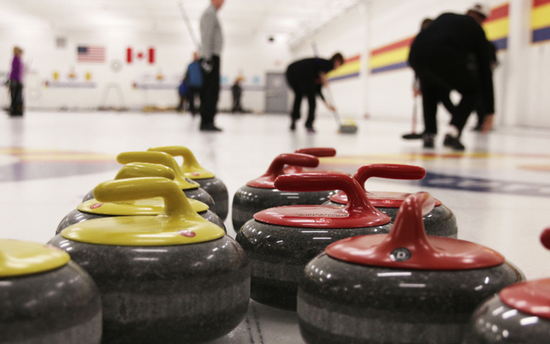 Curling stones lay on the ice as the Coyotes Curling Club Canada Week Bonspiel gets underway Friday, February 3, 2017 in Tempe, AZ. (Shane DeGrote/Cronkite News)