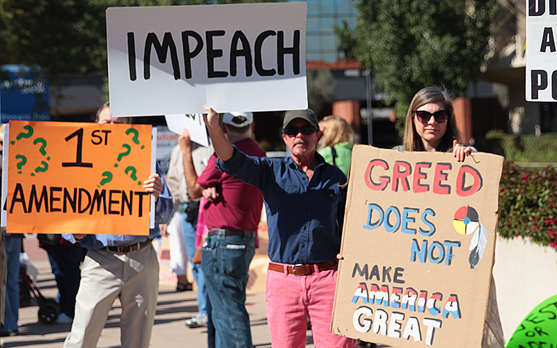 Protestors assemble outside Arizona Sen. Jeff Flake's office in the wake of Pres. Trump's executive orders on February 7, 2017 in central Phoenix. (Photo by Taryn Martin/Cronkite News).