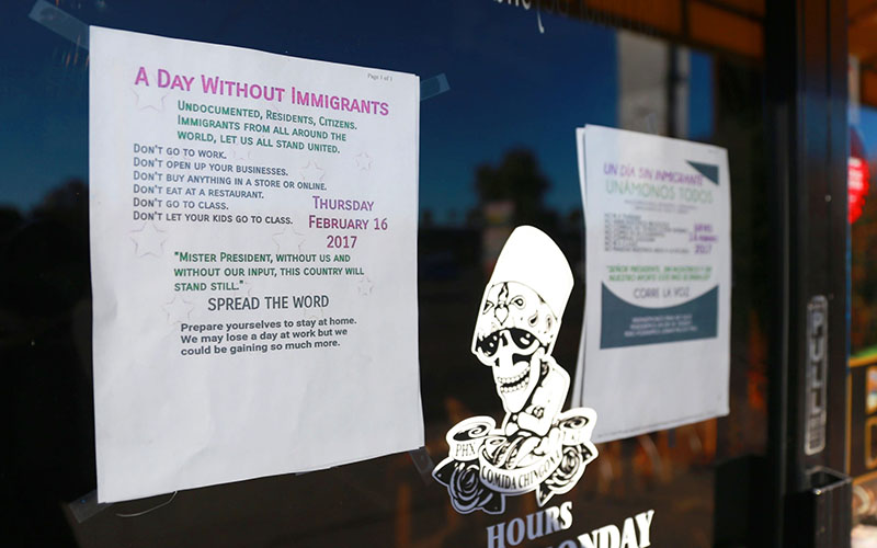 "A sign posted outside Barrio Cafe in Phoenix informs customers about ""A Day Without Immigrants,"" a demonstration to show what America would look like  without immigrants. (Photo taken by Taryn Martin/Cronkite News)"