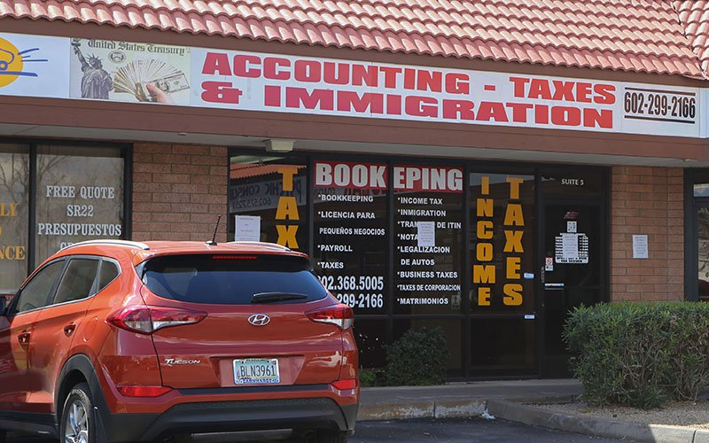A business advertising taxes and immigration services in Phoenix, Arizona. (Photo by Sarah Jarvis/Cronkite News)