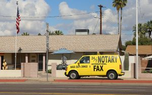 A 24/7 mobile notary service parked outside of a home in Phoenix, Arizona. (Photo by Sarah Jarvis/Cronkite News)