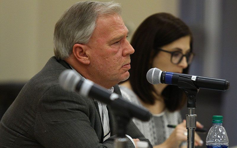 Patrick Cavanaugh, deputy director for Pima County  economic development, listens to public concerns about a proposed Monsanto greenhouse at a public meeting in Marana. (Photo by Taryn Martin/Cronkite News)