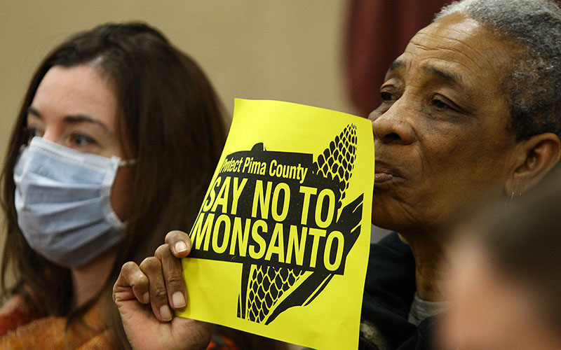 Pima County residents silently protested at a public meeting about a planned Monsanto greenhouse nearTucson. (Photo by Taryn Martin/Cronkite News)